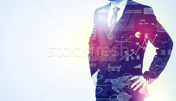 Man standing with graphs on the background Stock photo © ra2studio