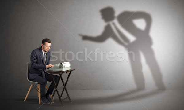 Man working hard and shadow arguing with him Stock photo © ra2studio