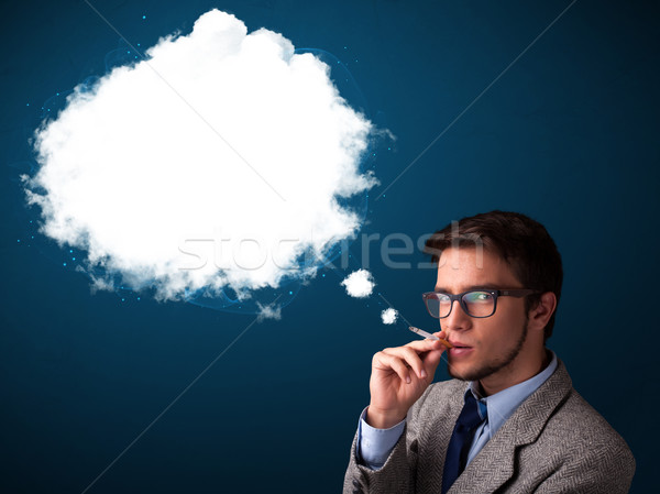 Stock photo: Young man smoking unhealthy cigarette with dense smoke