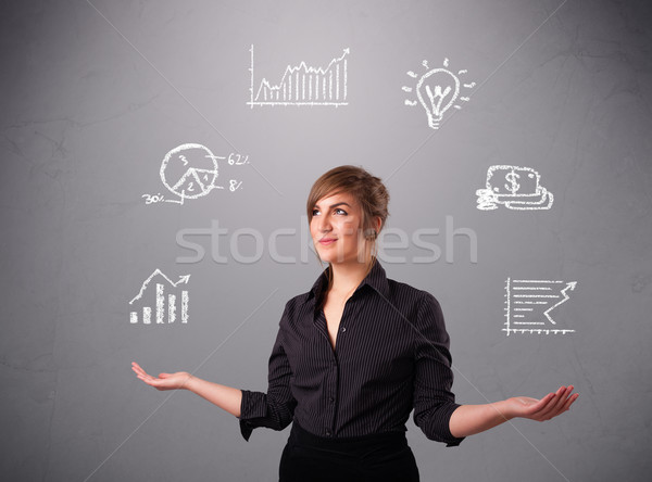 beautiful young woman juggling with statistics and graphs Stock photo © ra2studio