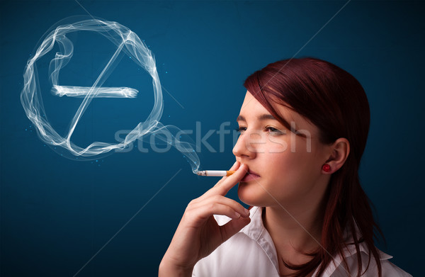 Young lady smoking unhealthy cigarette with no smoking sign Stock photo © ra2studio