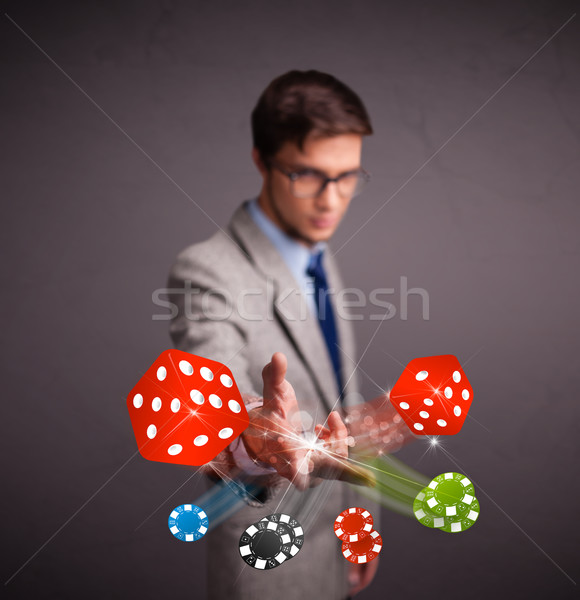 Attractive man throwing dices and chips Stock photo © ra2studio