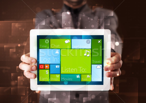 Young businessman holding a tablet with modern software operational system Stock photo © ra2studio