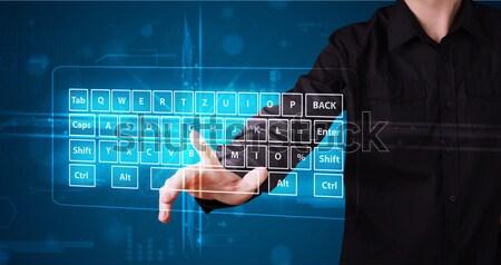 Girl pressing virtual type of keyboard Stock photo © ra2studio