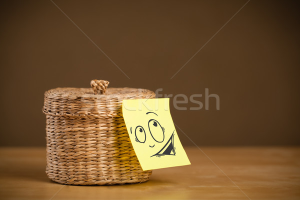 Post-it note with smiley face sticked on jewelry box Stock photo © ra2studio
