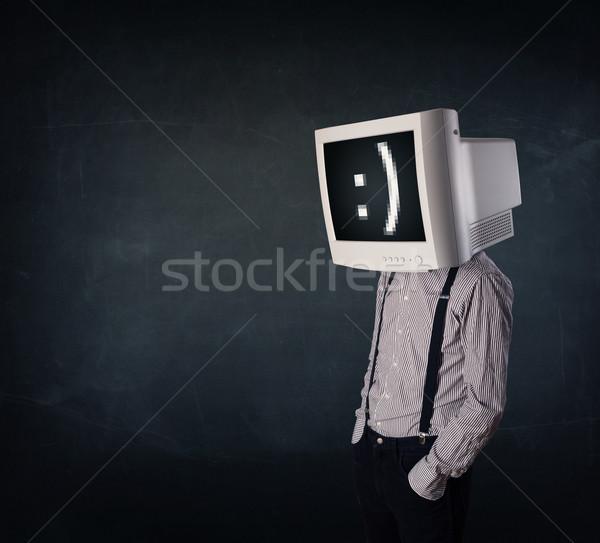 Engraçado jovem empresário monitor cabeça emoticon Foto stock © ra2studio