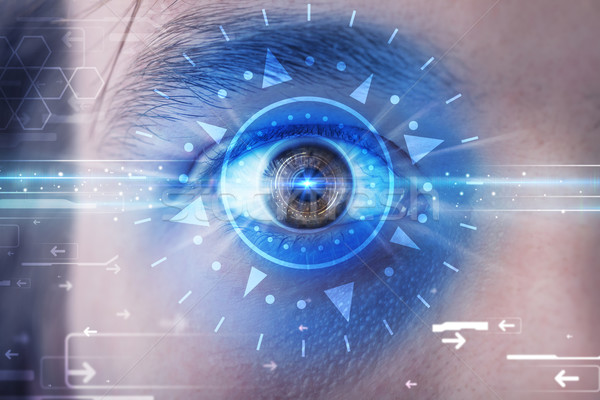 Cyber man with technolgy eye looking into blue iris Stock photo © ra2studio