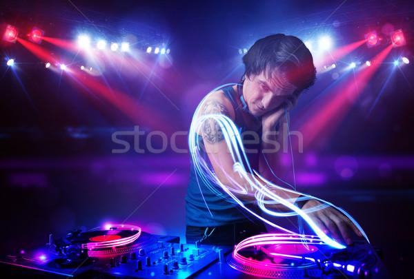 Diskjokey oynama müzik ışık etkileri Stok fotoğraf © ra2studio