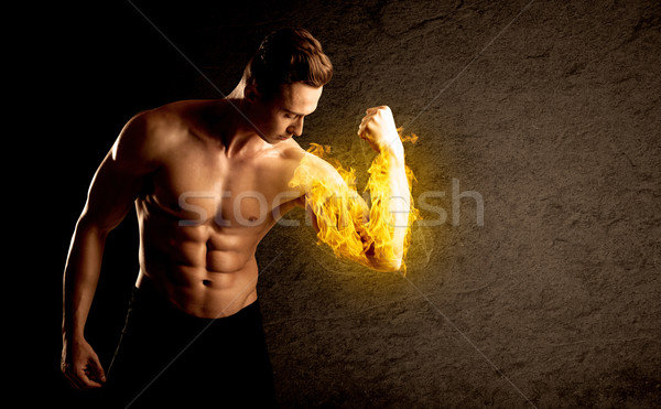 Musculaire bodybuilder poids flaming biceps Photo stock © ra2studio