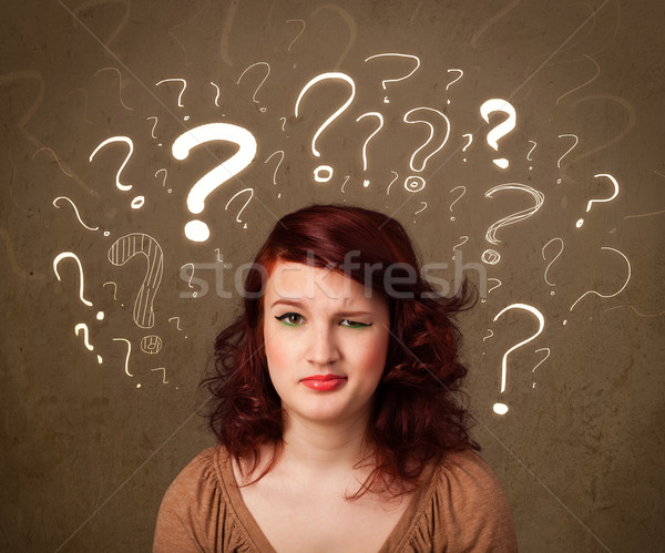 girl with question mark symbols around her head Stock photo © ra2studio