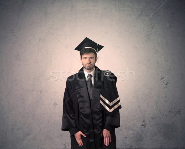 Portrait of a young graduate student on grungy background Stock photo © ra2studio