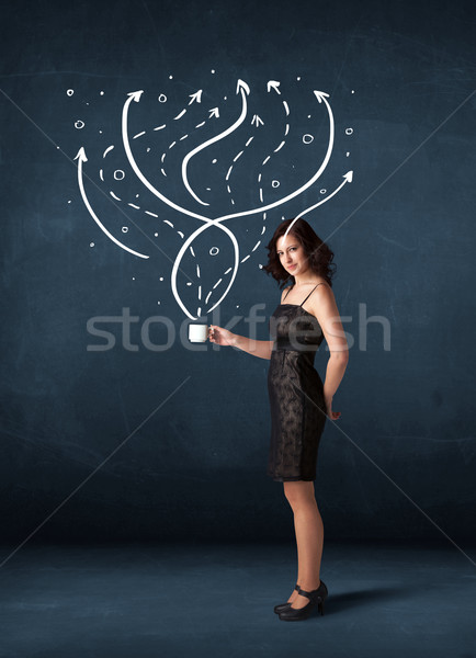 Businesswoman holding a white cup with lines and arrows Stock photo © ra2studio