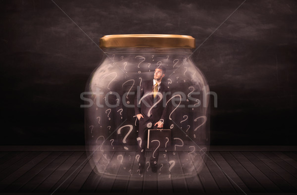 Businessman locked into a jar with question marks concept Stock photo © ra2studio