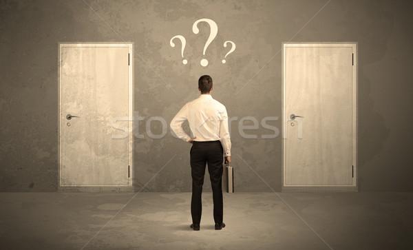 Zakenman permanente deuren verkoper twee Stockfoto © ra2studio
