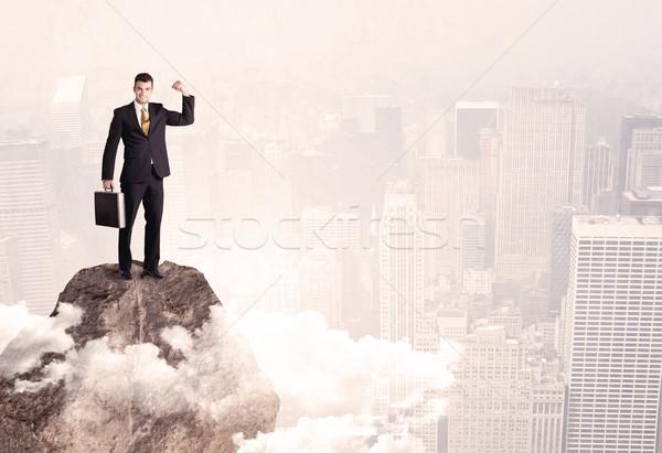 幸せ ビジネスマン 立って 石 先頭 エレガントな ストックフォト © ra2studio