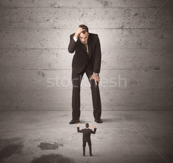 Huge business guy looking at small coworker Stock photo © ra2studio