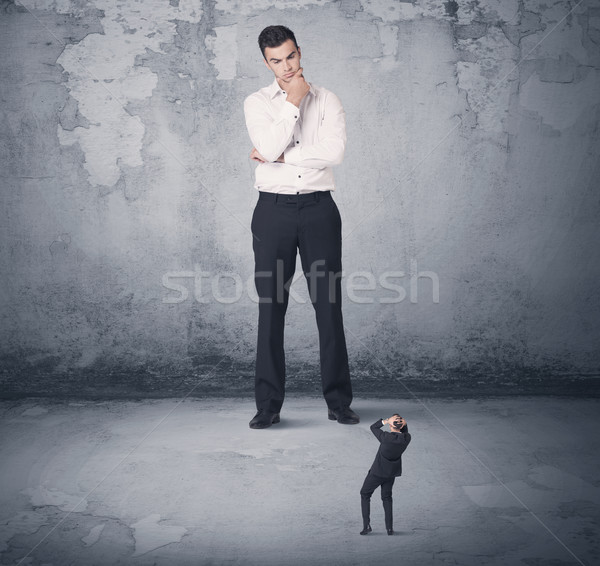 Big business bully looking at small coworker Stock photo © ra2studio