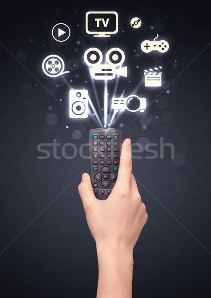 Mão controle remoto mídia ícones fora Foto stock © ra2studio