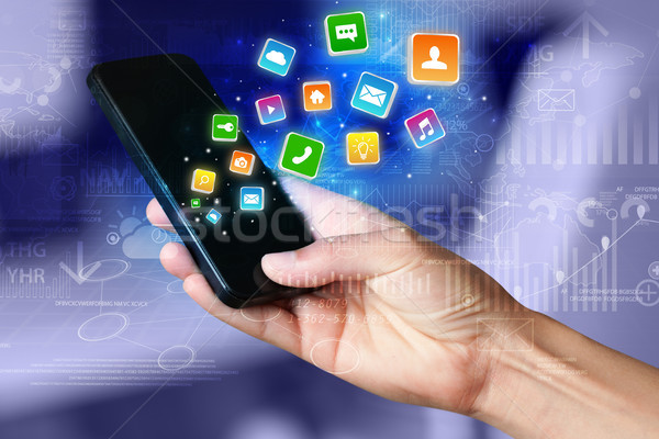 Hand using phone with bouncing application graphs and report con Stock photo © ra2studio