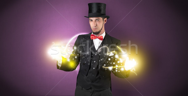 Magician holding his power on his hand Stock photo © ra2studio