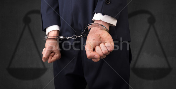 Arrestato uomo equilibrio imprenditore manette mani Foto d'archivio © ra2studio