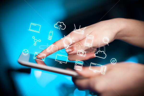 Fingers touching tablet with icons Stock photo © ra2studio