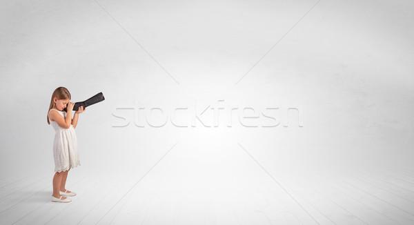 Kid looking through spyglass to an empty space Stock photo © ra2studio