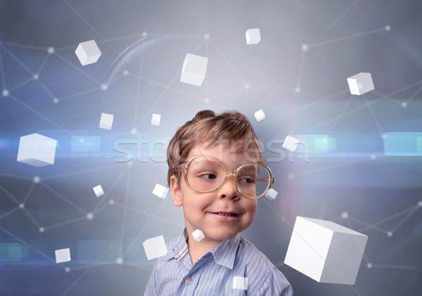 Cute kid with luminous cubes around Stock photo © ra2studio