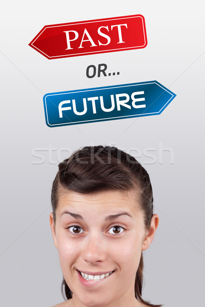 Młoda dziewczyna patrząc pozytywny negatywne znaki głowie Zdjęcia stock © ra2studio