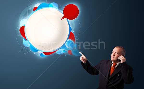 businessman in suit making phone call and presenting abstract modern speech bubble Stock photo © ra2studio