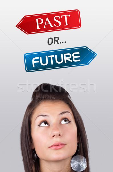 Jong meisje naar positief negatieve borden hoofd Stockfoto © ra2studio