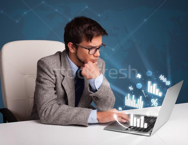 молодым человеком сидят столе набрав ноутбука Сток-фото © ra2studio