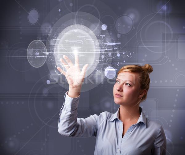 Attrattivo giovani imprenditrice toccare abstract alta tecnologia Foto d'archivio © ra2studio