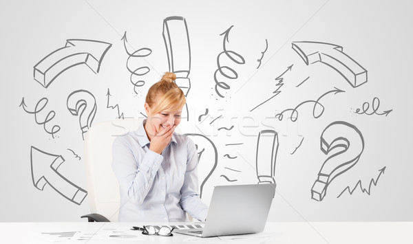 Attractive young businesswoman brainstorming with drawn arrows and symbols Stock photo © ra2studio