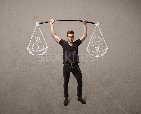 Stock photo: muscular man trying to get balanced