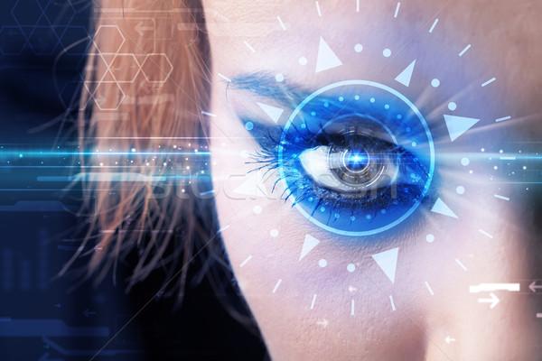 Cyber girl with technolgy eye looking into blue iris Stock photo © ra2studio