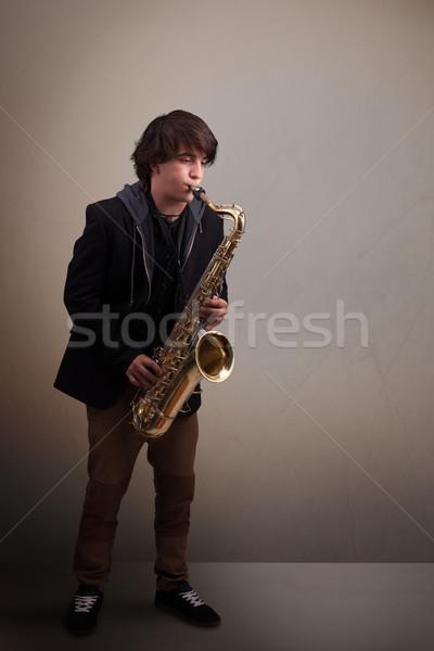 小さな ミュージシャン 演奏 サクソフォン ハンサム 音楽 ストックフォト © ra2studio