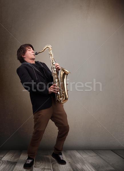 молодые музыканта играет саксофон красивый музыку Сток-фото © ra2studio