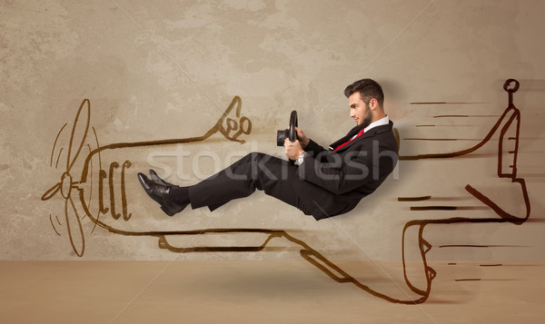 Grappig piloot rijden vliegtuig muur Stockfoto © ra2studio