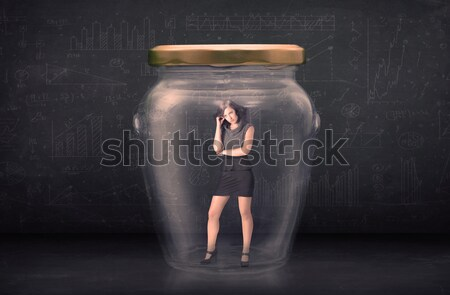 Stock photo: Business man closed into a glass jar concept