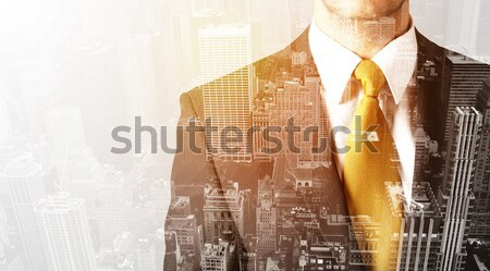Business man looking at overlay city background Stock photo © ra2studio