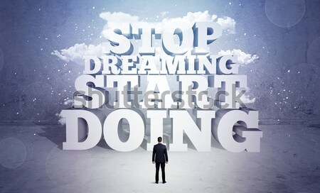 Stock photo: Businessman is afraid and needs motivation