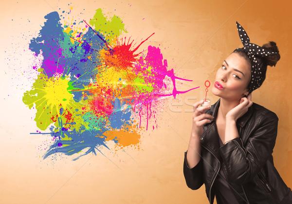 Aranyos lány fúj színes csobbanás graffiti Stock fotó © ra2studio