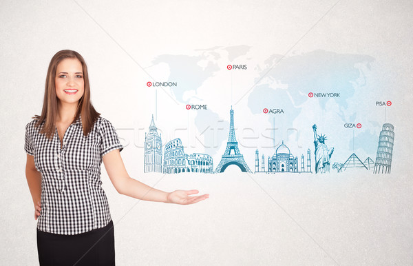 Business woman presenting map with famous cities and landmarks Stock photo © ra2studio
