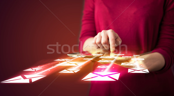 Hand holding tablet and sending email icons Stock photo © ra2studio