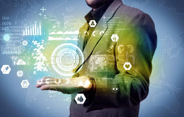 Businessman analyzing medical data Stock photo © ra2studio