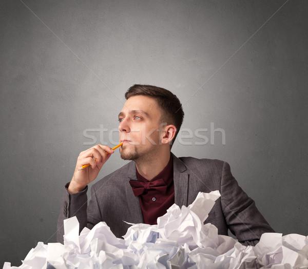Businessman behind crumpled paper Stock photo © ra2studio