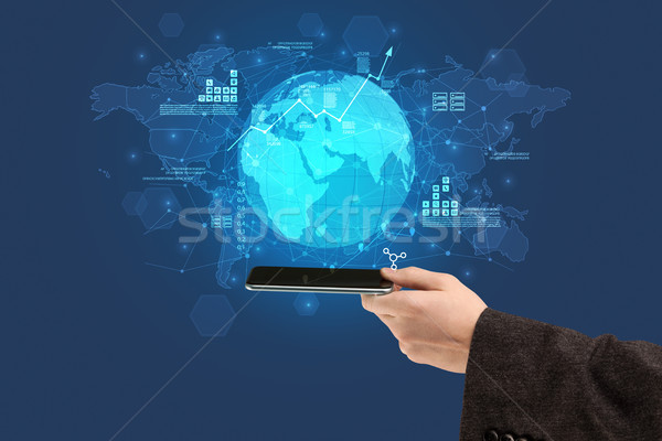 Hand touching phone with global estate report concept Stock photo © ra2studio