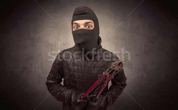 Burglar with tool. Stock photo © ra2studio