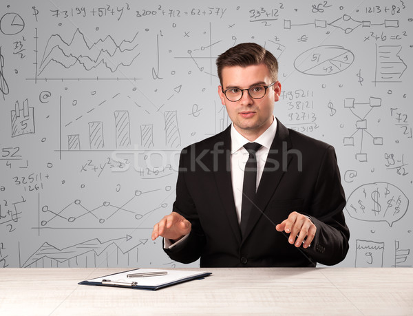 Businessman sitting at a desk Stock photo © ra2studio